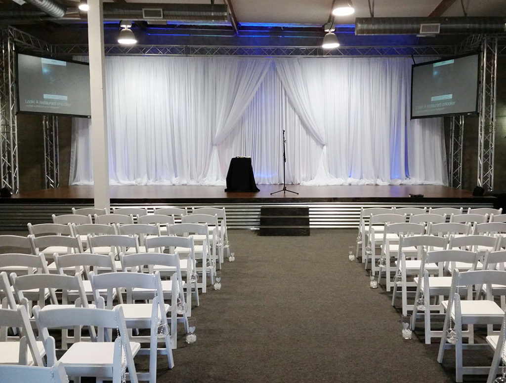 Pipe & Drape Rentals Draping Rentals White Draping White Fancy Resin Chairs Graduation