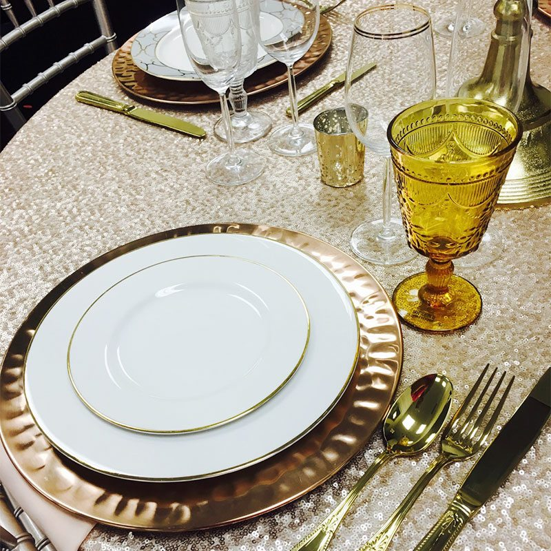 Debutante colored glassware rental amber, burnt orange colored glassware rental wedding tabletop rentals Los Angeles, CA Newport Beach Huntington Beach Hammered Copper Charger Plate rental Solid Gold Flatware rentals Glitz Sequins table linen rentals event rentals wedding inspiration